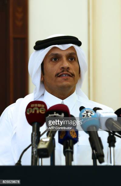 Qatari Foreign Minister Sheikh Mohammed bin Abdulrahman AlThani listens as his Italian counterpart speaks during a press conference in Doha on August...