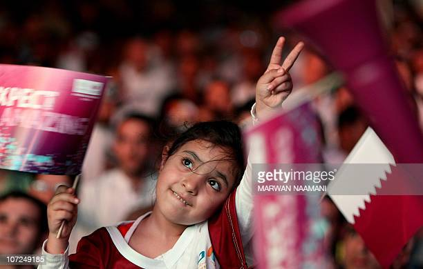 A Qatari girl celebrates in Doha after the tiny Gulf state was chosen to host the 2022 World Cup on December 2 2010 Qatar became the first Arab...