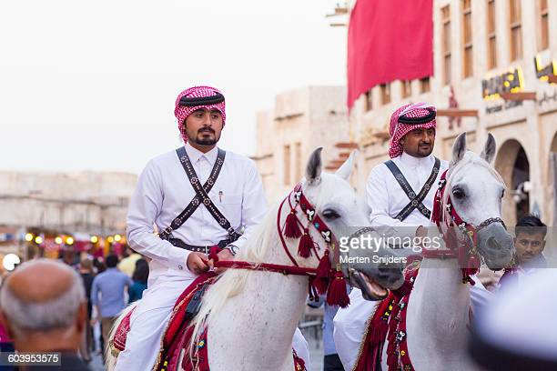 Qatari guards on Arabian horses in souq