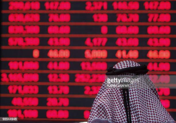 A Qatari investor follows the stock market activity at the Doha Securities Market on December 1 2009 Qatari stocks lost a massive 83 percent by the...