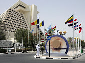 Qatari man walks 13 June 2005 in front of the Sheraton Hotel in Doha where the second Group of 77 and China South Summit will be held 1516 June...