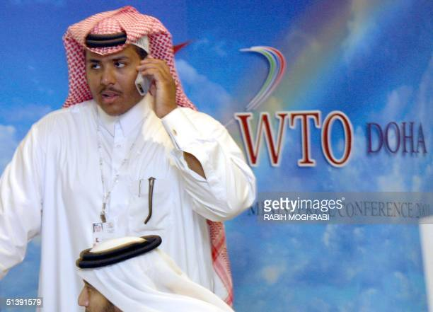 Qatari official talks on his mobile phone on the second day of the World Trade Organiation conference in Doha 10 November 2001 WTO ministers will try...