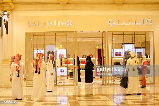 Qatari people in their traditional clothes called dishdasha and abaya are pictured at the luxury part of Villagio shopping mall on December 25 2011...