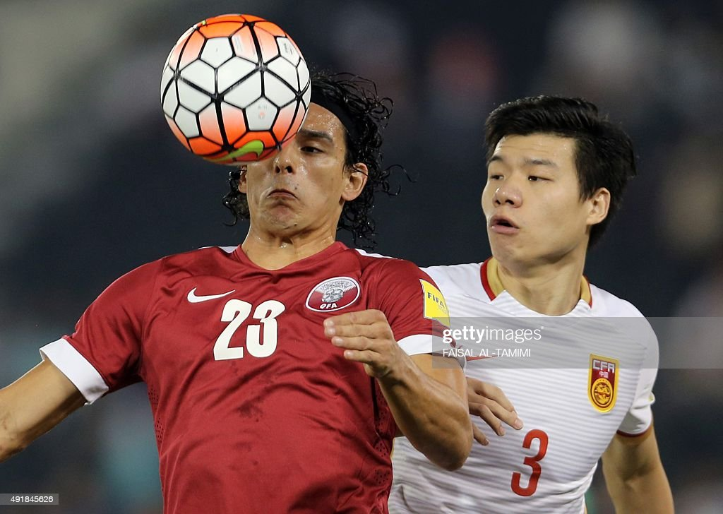 Qatari player Sebastian Soria controls the ball ahead of Chinese player Mei Fang during the AFC qualifying football match for the 2018 FIFA World Cup...