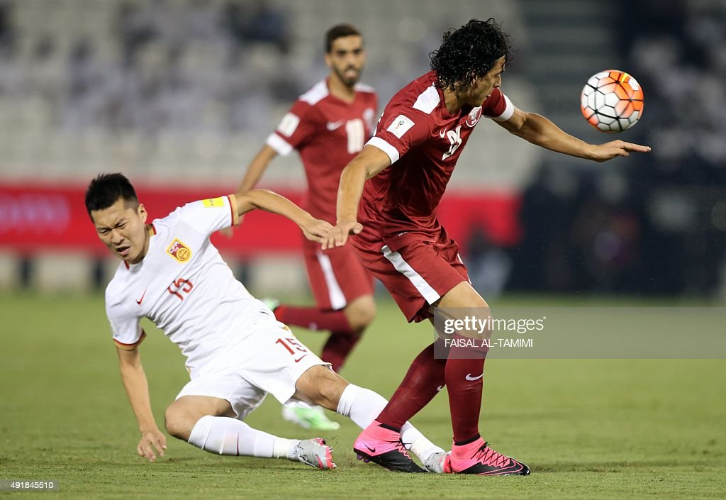 Qatari player Sebastian Soria controls the ball ahead of Chinese player Wu Xi during the AFC qualifying football match for the 2018 FIFA World Cup...