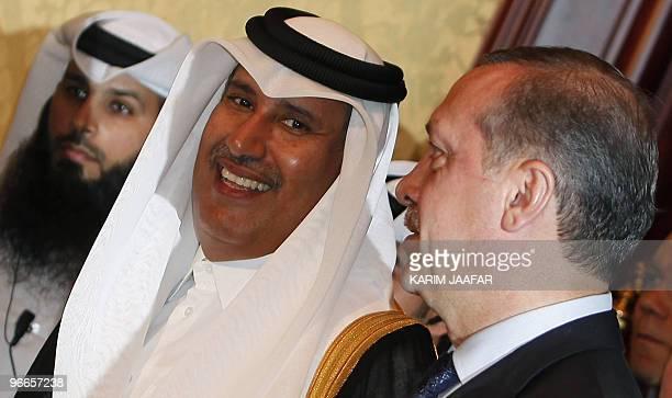 Qatari Premier and Foreign Minister Sheikh Hamad bin Jassem bin Jabr alThani arrives with Turkish Prime Minister Recep Tayyip Erdogan to attend the...
