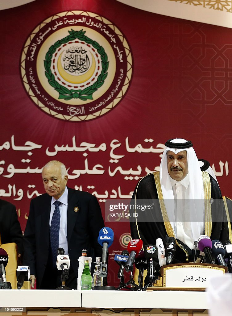 Qatari Prime Minister and Foreign Minister Sheikh Hamad bin Jassem al-Thani (R) and Arab League Secretary General Nabil al-Arabi arrive for a press conference during the Arab League summit in the Qatari capital, Doha, on March 26, 2013.