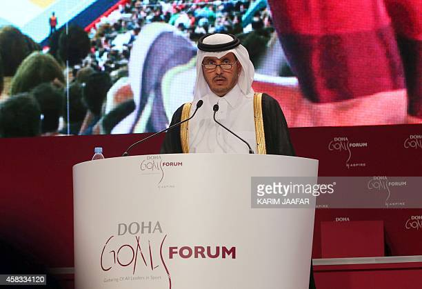 Qatari Prime Minister Sheikh Abdullah bin Nasser bin Khalifa alThani talks during the Doha Goals summit in the Qatari capital on November 3 2014 The...