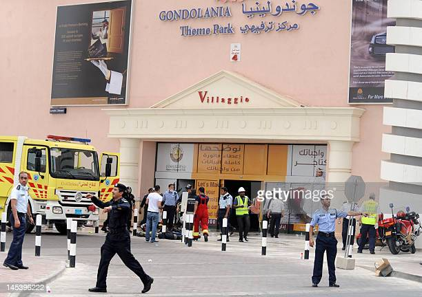 Qatari security forces and police clear traffic outside Doha's Villagio Mall after a fire broke out at the Gulf emirate's main shopping centre on May...
