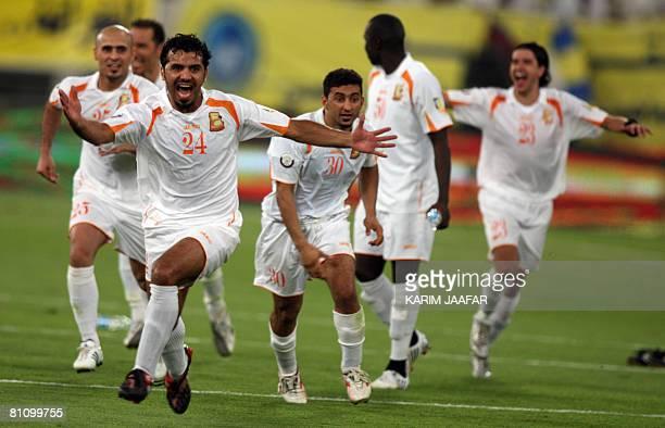 Qatari Umm Salal club players celebrate after winning the final match against alGharrafa club of the Emir Cup football tournament between AlGharrafa...