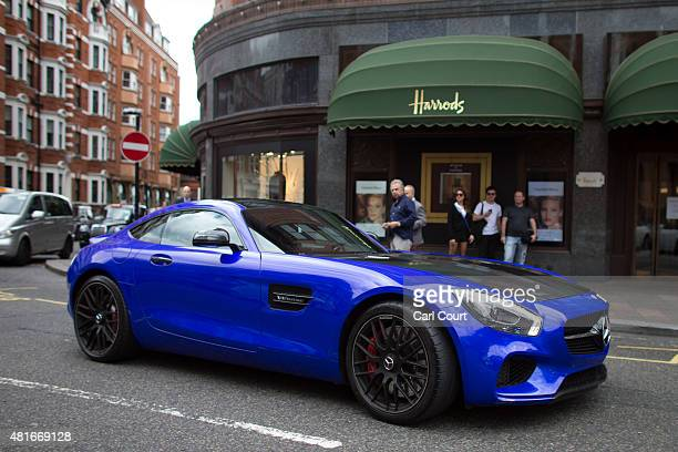 Qatariregistered Mercedes v8 biturbo AMG GTS is driven past Harrods on July 23 2015 in London England London has become known in recent years for a...