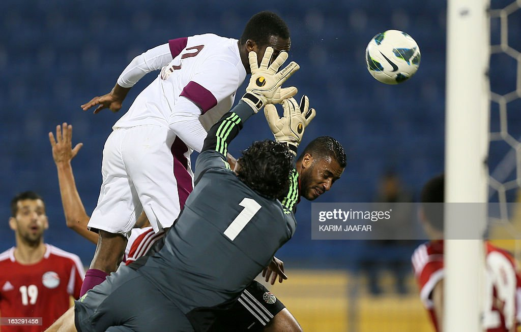 Qatar's Abdul Karim Hasan (C) heads the ball before scoring a first goal during the friendly football match Qatar versus Egypt in the Qatari capital Doha on March 7, 2013. The match comes in the frame of the both national teams preparation for Asian and African qualification rounds for FIFA 2014 World Cup Finals in Brazil.
