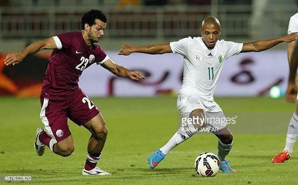 Qatar's Ahmed ElSayed defends against Algeria's Yacine Brahimi during the friendly football match between Qatar and Algeria at Abdullah bin Nasser...
