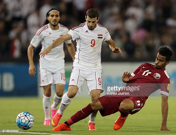 Qatar's Akram Afif tackles Syria's Mahmoud alMawas during the 2018 World Cup qualifying football match between Qatar and Syria at the Jassim Bin...