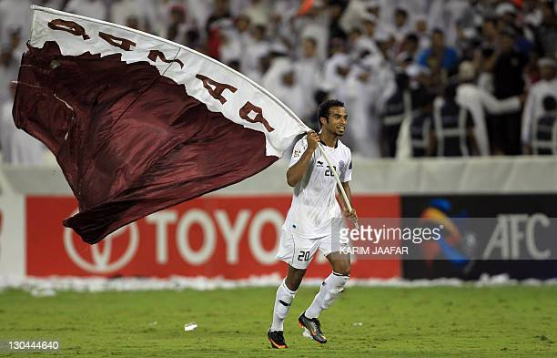 Qatar's Al Sadd forward Ali Afif celebrates after the match against South Korea's Suwon Samsung Bluewings during their semifinal football match in...