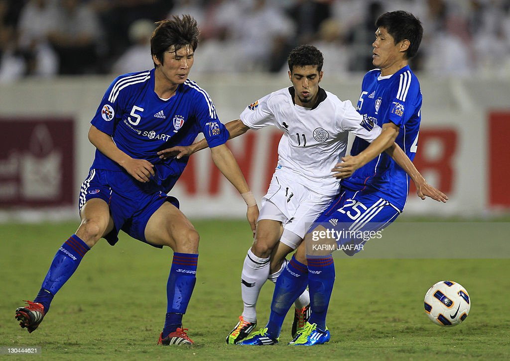 Qatar's Al Sadd forward Hasan Al-Haidous (C) fights for the ball with South Korea's Suwon Samsung Bluewings players Park Hyun Bem (L) and Choi Sung Hwan during their semi-final football match in the AFC Champions League in Doha, on October 26, 2011. Suwon Samsung Bluewings won the match 1-0.