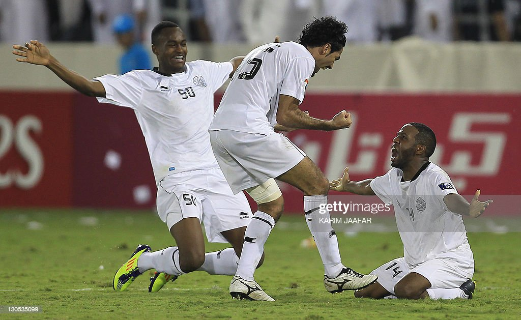 Qatar's Al Sadd players Abdul Karim Hasan (L) Talal Al Bloshi (C) and Khalfan Ibrahim (R) celebrate after the match against South Korea's Suwon Samsung Bluewings during their semi-final football match in the AFC Champions League in Doha, on October 26, 2011. Suwon Samsung Bluewings won the match 1-0.