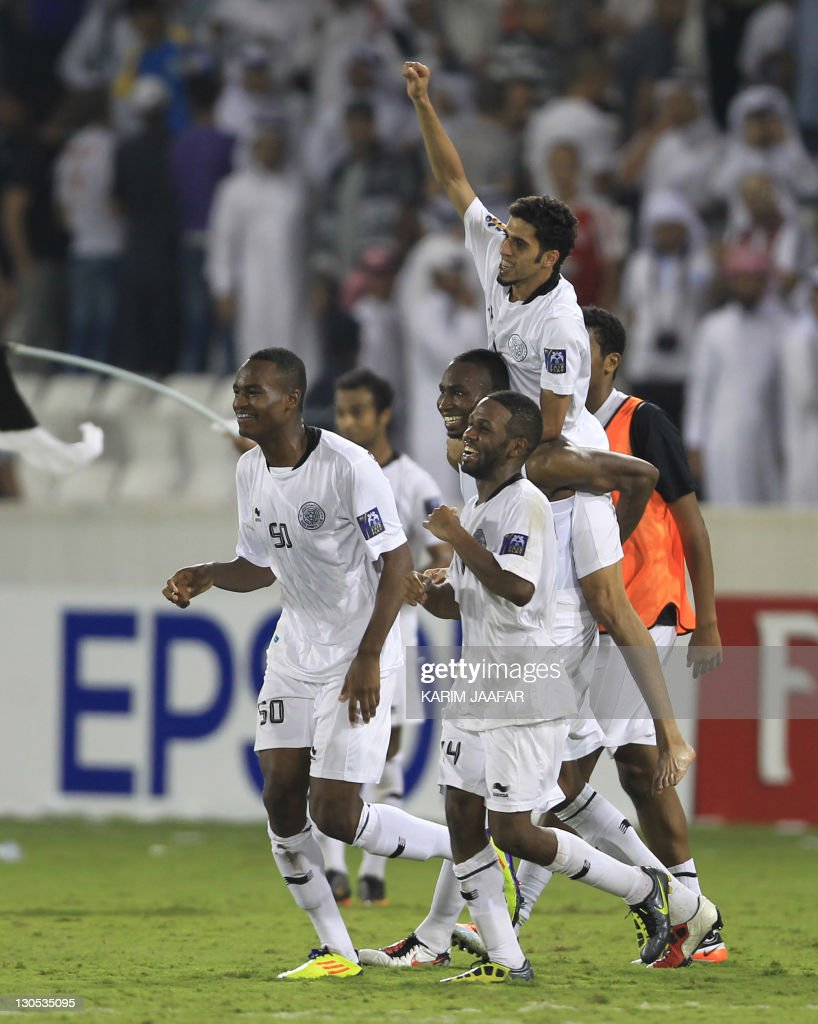 Qatar's Al Sadd players celebrate after the match against South Korea's Suwon Samsung Bluewings during their semi-final football match in the AFC Champions League in Doha, on October 26, 2011. Suwon Samsung Bluewings won the match 1-0.