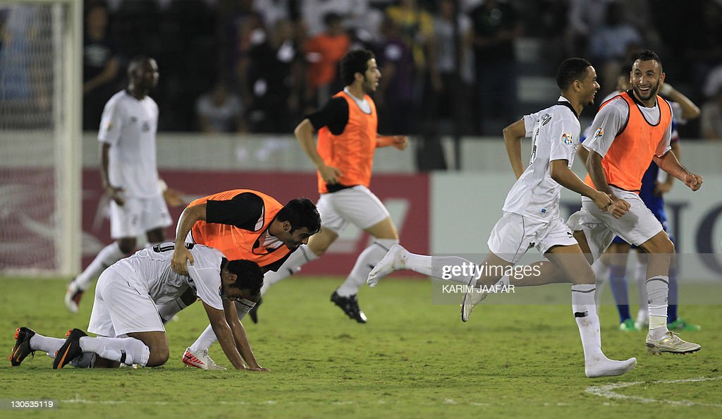 Qatar's Al Sadd players celebrate after their match against South Korea's Suwon Samsung Bluewings during their semi-final football match in the AFC Champions League in Doha, on October 26, 2011. Suwon Samsung Bluewings won the match 1-0.