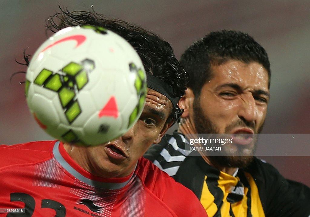 Qatar's Algerian player Rafik Halliche vies for the ball against Lekhwiya's Sebastian Soria during their Qatar Stars League football match at the...