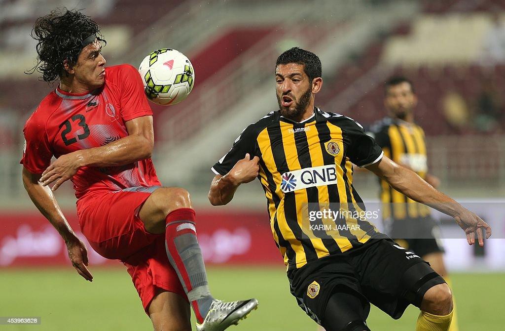 Qatar's Algerian player Rafik Halliche vies for the ball against Lekhwiya's Sebastian Soria during their Qatar Stars League football at the Abdullah...