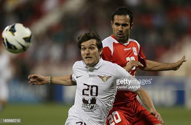 Qatar's AlJaish player Wagner Renan Ribeiro challenges Mohammad Nosrati of Iran's Teraktor Sazi Tabriz club during their AFC Champions League...