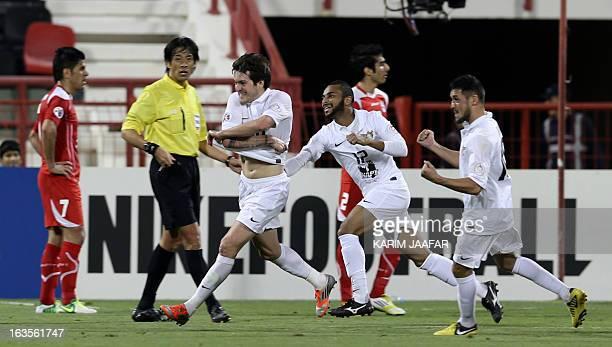 Qatar's AlJaish players Wagner Renan Ribeiro celebrates with his teammate players after scoring a goal against Iran's Teraktor Sazi Tabriz club...