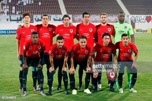 Qatar's AlRayyan SC's players pose for a group picture prior to their AFC Champions League group D football match against UAE AlWahda FC at AlNahyan...
