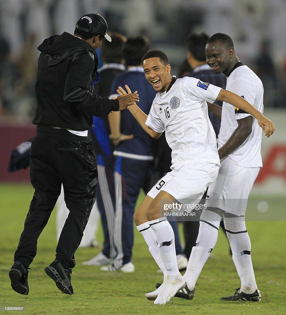 Qatar's Al-Sadd Nasser Nabil (C) celebrates with his team players Abdul Kader Keita (L) and Abdulla Koni (R) after their match against South Korea's Suwon Samsung Bluewings during their semi-final football match in the AFC Champions League in Doha, on October 26, 2011. Suwon Samsung Bluewings won the match 1-0. AFP PHOTO/KARIM JAAFAR