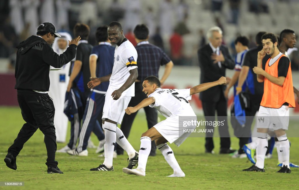 Qatar's Al-Sadd Nasser Nabil (C) celebrates with his team players Abdul Kader Keita (L) and Abdulla Koni (2nd L) after the match against South Korea's Suwon Samsung Bluewings during their semi-final football match in the AFC Champions League in Doha, on October 26, 2011. Suwon Samsung Bluewings won the match 1-0.