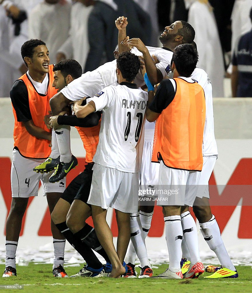 Qatar's Al-Sadd players celebrate after the match against South Korea's Suwon Samsung Bluewings during their semi-final football match in the AFC Champions League in Doha, on October 26, 2011. Suwon Samsung Bluewings won the match 1-0.