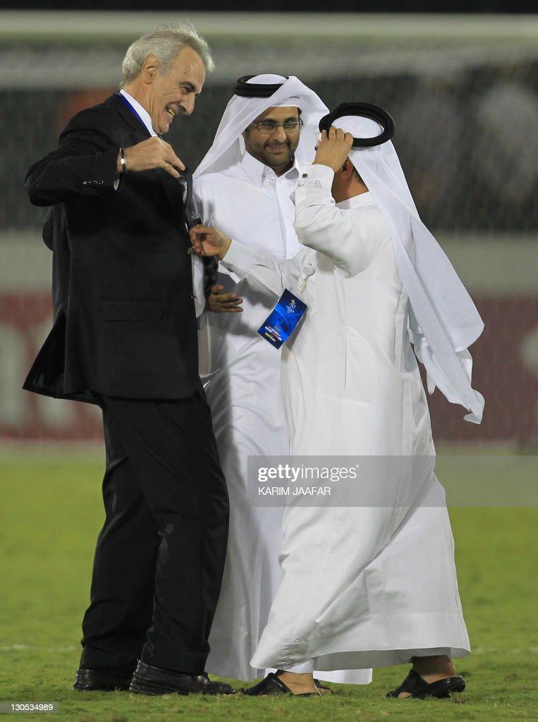 Qatar's Al-Sadd Secretary General Jassem al-umaihi (R) celebrates with the teams' Uruguayan coach Jorge Fossati (L) and Salem al-Ali the team manager (C) after the match against South Korea's Suwon Samsung Bluewings,during their AFC Champions League semi-final football match at Al-Sadd stadium in Doha, on October 26, 2011. Suwon won 1-0.