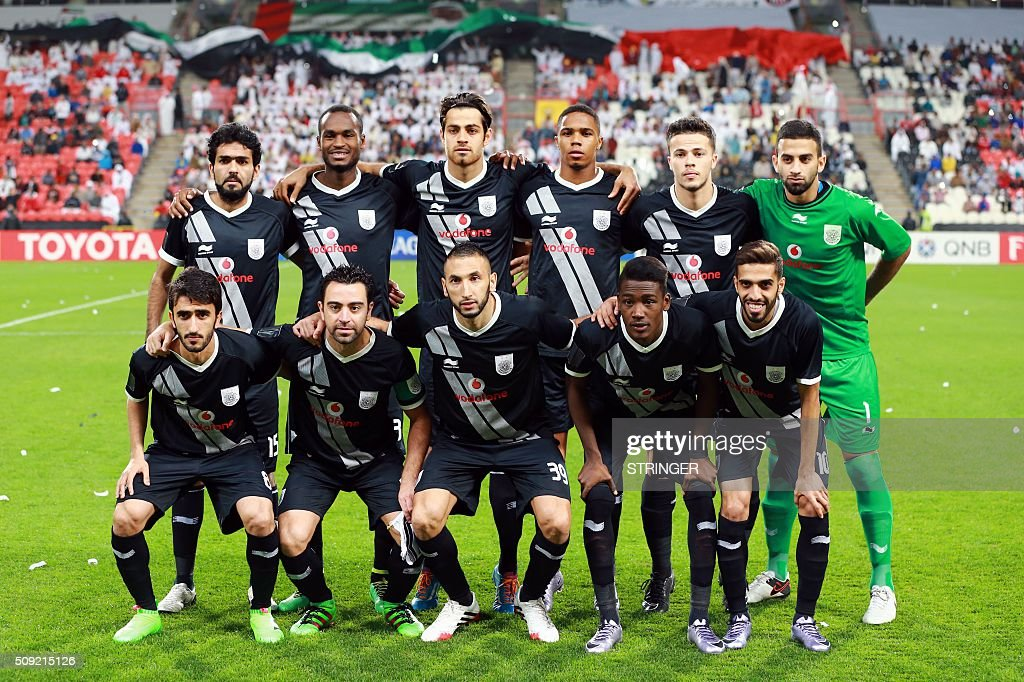 Qatar's Al-Sadd starting eleven pose for a team photo prior to the start of their AFC Champions League third round qualifying football match against UAE's Al-Jazeera club at the Mohammed Bin Zayed Stadium in Abu Dhabi on February 9, 2016. / AFP / STRINGER