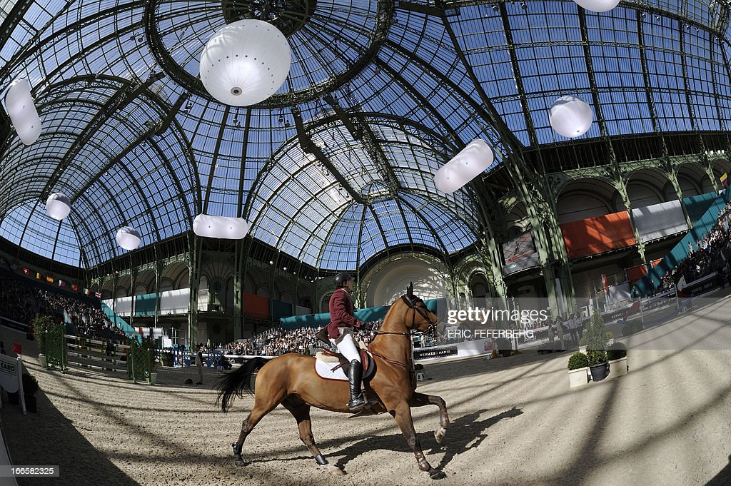 Qatar's Bassem Hassan Mohammed riding Canterino competes in the International Jumping Competition 'Grand Prix Hermes' on April 14, 2013, at the Grand Palais in Paris.
