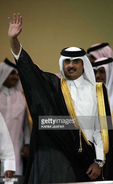 Qatar's Crown Prince Sheikh Tamim bin Hamad alThani waves upon his arrival at Qatar Stadium to attend the Crown Prince Cup football finals on April...