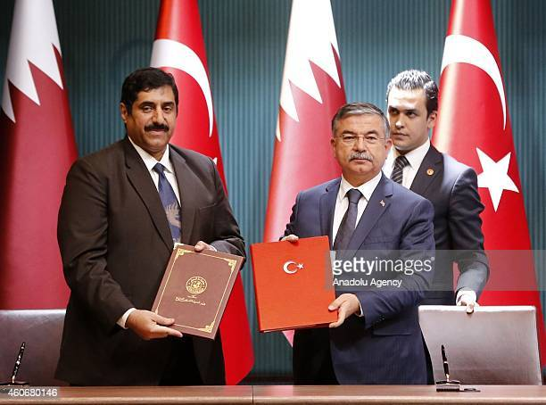Qatar's Defence Minister Major General Hamad bin Ali AlAttiyah and Turkey's Defence Minister Ismet Yilmaz pose during the ceremony of the signature...