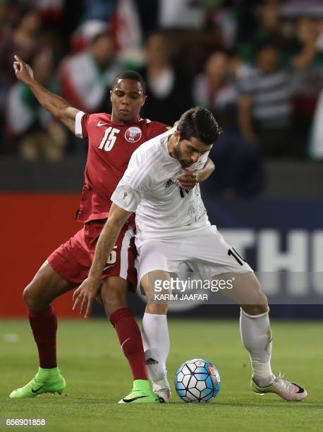 Qatar's defender Perdo Correia tackles Iran's Karim Ansari Fard during the World Cup 2018 Asia qualifying football match between Qatar and Iran at...