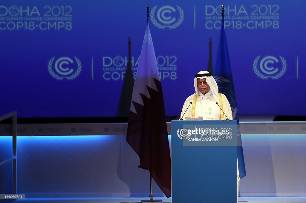 Qatar's deputy Prime minister and 18th Conference of the Parties (COP18) president Abdullah bin Hamad Al-Attiyah delivers a speech during the opening ceremony of the 18th United Nations Convention on Climate Change in Doha on November 26, 2012. Nearly 200 world nations launched today a new round of talks to review commitments to cutting climate-altering greenhouse gas emissions. The two-week conference comes amid a welter of reports warning that extreme weather events like superstorm Sandy may become commonplace if mitigation efforts fail. AFP PHOTO / AL-WATAN DOHA / KARIM JAAFAR OUT ==