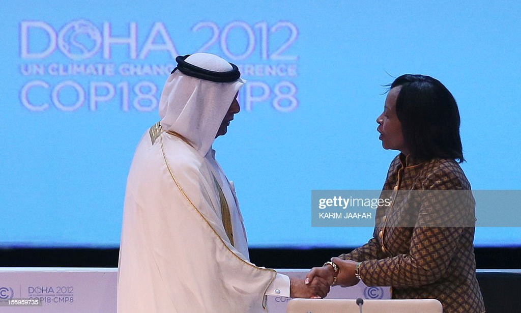 Qatar's deputy Prime minister and 18th Conference of the Parties (COP18) president Abdullah bin Hamad Al-Attiyah (L) shakes hands with South Africa's Foreign Minister and President of the 17th United Nations (UN) climate change conference, Maite Nkoana-Mashabane, during the opening ceremony of the 18th United Nations Convention on Climate Change in Doha on November 26, 2012. Nearly 200 world nations launched today a new round of talks to review commitments to cutting climate-altering greenhouse gas emissions. The two-week conference comes amid a welter of reports warning that extreme weather events like superstorm Sandy may become commonplace if mitigation efforts fail.