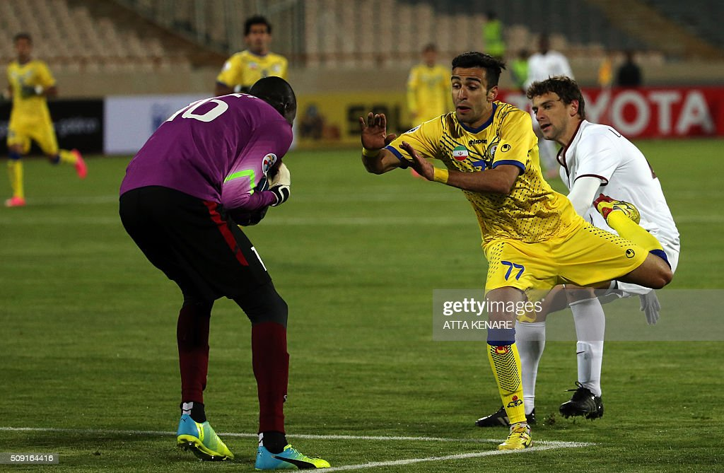 Qatar's El Jaish goalkeeper Ababacar Khalifa N'Diaye (L) saves the the ball as Naft Tehran's Ali Gorbhani (R) tries to score with a header during their AFC Champions League 3rd qualifying round play-off football match at the Azadi stadium in Tehran on February 9, 2016. / AFP / ATTA KENARE