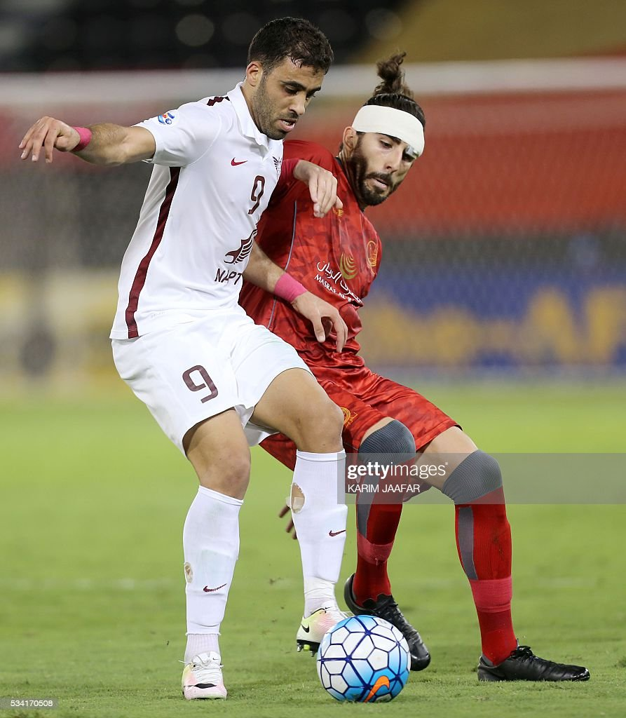 Qatar's El-Jaish club player Abderrazak Hamdallah (L) vies for the ball with Qatar's Lekhwiya club player Chico Flores during their Asian Champions League football match at Jassim Bin Hamad Stadium in the capital Doha on May 25, 2016. / AFP / KARIM