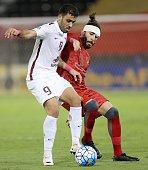 Qatar's ElJaish club player Abderrazak Hamdallah vies for the ball with Qatar's Lekhwiya club player Chico Flores during their Asian Champions League...