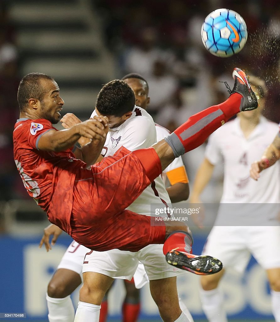 Qatar's El-Jaish club player Murad Naji (back) fights for the ball with Qatar's Lekhwiya club player Ali Afif during their Asian Champions League football match at Jassim Bin Hamad Stadium in the capital Doha on May 25, 2016. / AFP / KARIM