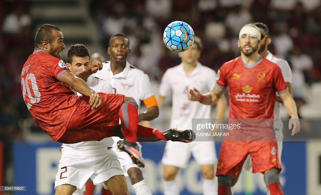 Qatar's El-Jaish club player Murad Naji (2-L) fights for the ball with Qatar's Lekhwiya club player Ali Afif (L) during their Asian Champions League football match at Jassim Bin Hamad Stadium in the capital Doha on May 25, 2016. / AFP / KARIM