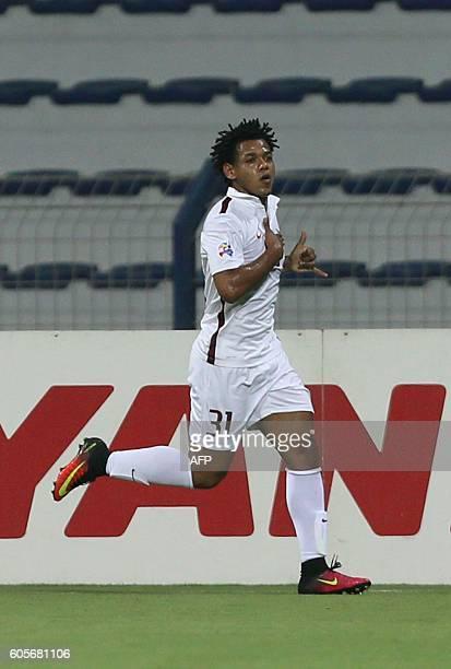 Qatar's ElJaish club player Romarinho Ricardo celebrates scoring a goal against United Arab Emirate's AlNasr team during their Asian Champions League...