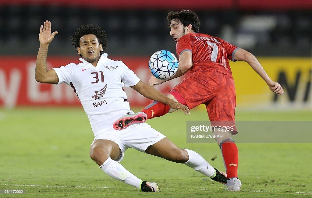 Qatar's El-Jaish club player Romarinho Ricardo (L) vies for the ball with Qatar's Lekhwiya club player Khalid Muftah during their Asian Champions League football match at Jassim Bin Hamad Stadium in the capital Doha on May 25, 2016. / AFP / KARIM
