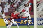 Qatar's ElJaish defender Abdurahman Mohammad and midfielder Khaled alZrigi defend as Qatar's Lekhwiya defender Chico Flores tries to score during...