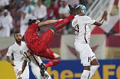 Qatar's ElJaish defender Abdurahman Mohammad defends as Qatar's Lekhwiya defender Chico Flores tries to score during their AFC Champions League round...