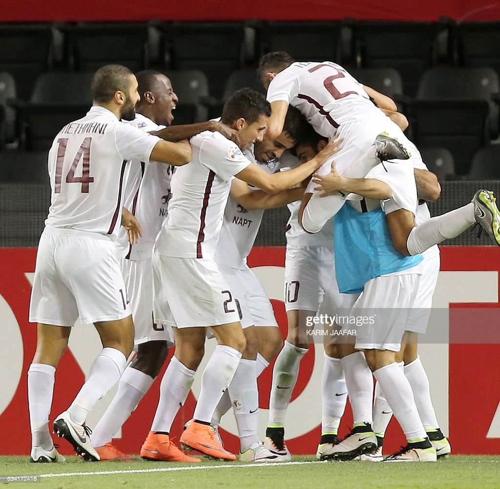 Qatar's El-Jaish's players celebrate after scoring a goal against Qatar's Lekhwiya during their Asian Champions League round 16 football match at the Jassim Bin Hamad stadium in the capital Doha on May 25, 2016. / AFP / KARIM