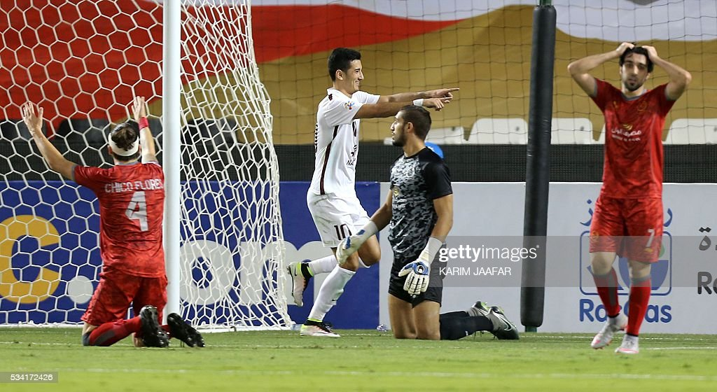 Qatar's El-Jaish's Sardor Rashidov (C) celebrates after scoring the first goal against Qatar's Lekhwiya during their Asian Champions League football match at the Jassim Bin Hamad stadium in the capital Doha on May 25, 2016. / AFP / KARIM